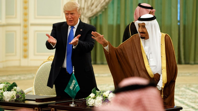 U.S. President Donald Trump and Saudi King Salam wave to the crowd during a signing ceremony at the Royal Court Palace, Saturday, May 20, 2017, in Riyadh. (AP /Evan Vucci)