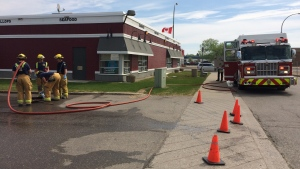Regina fire crews clean a scene on the 900 block of Albert Street on Saturday, May 20, 2017. A 19-year-old man found injured hours earlier, just before 2:30 a.m., at the scene later died in hospital. (Taylor Rattray/CTV Regina)