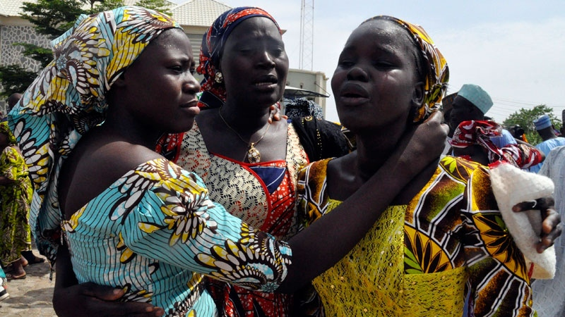 Family members celebrate as they embrace a relative, one of the released kidnapped schoolgirls, in Abuja, Nigeria, Saturday, May 20, 2017.  (AP /Olamikan Gbemiga)