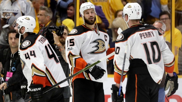 da281d94c58 Anaheim Ducks center Ryan Getzlaf (15) congratulates center Nate Thompson  (44) and right wing Corey Perry (10) after the Ducks beat the Nashville  Predators ...
