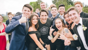 A group of Vancouver high school students getting ready for their prom pose with Prime Minister Justin Trudeau. (Photo by Cam Corrado)
