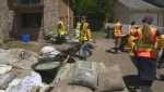 Volunteers help remove sandbags from properties around Montreal.
