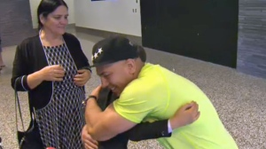 Farid Mustamandy embraces his son Naween at the Calgary International Airport on Saturday afternoon.
