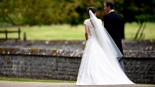 Pippa Middleton, second right and James Matthews walk, after their wedding ceremony, at St Mark's Church in Englefield, England. (Justin Tallis / Pool Photo via AP)