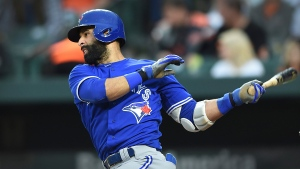 Toronto Blue Jays' Jose Bautista follows through on a single against the Baltimore Orioles during the first inning of a baseball game, Saturday, May 20, 2017, in Baltimore. (AP Photo / Gail Burton)
