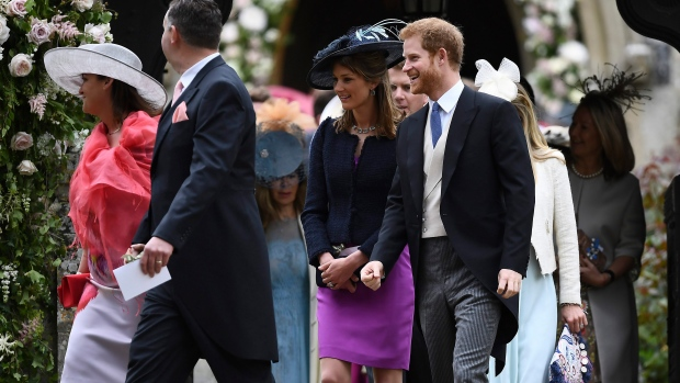 Britain's Prince Harry, right, leaves St Mark's Church after the wedding ceremony of Pippa Middleton to James Matthews, at St Mark's Church in Englefield, England Saturday, May 20, 2017. (Justin Tallis/Pool Photo via AP)