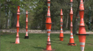 Ten columns of orange cones, stacked end to end, are spread out on the museum's front lawn, and another 11 will be added by October. (CTV Montreal)