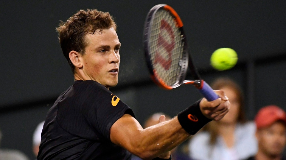 FILE -- Vasek Pospisil, of Canada, returns a shot to Andy Murray, of Great Britain, at the BNP Paribas Open tennis tournament, n Indian Wells, Calif., on Saturday, March 11, 2017. (AP Photo/Mark J. Terrill)