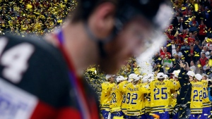 Sweden players celebrate following the Ice Hockey World Championships final match between Canada and Sweden in the LANXESS arena in Cologne, Germany, Sunday, May 21, 2017. (AP Photo/Petr David Josek)