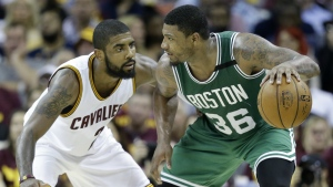 Boston Celtics' Marcus Smart looks to drive on Cleveland Cavaliers' Kyrie Irving during the second half of Game 3 of the NBA basketball Eastern Conference finals in Cleveland on Sunday, May 21, 2017. (AP / Tony Dejak)