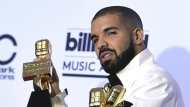 Drake poses in the press room with his 13 awards at the Billboard Music Awards at the T-Mobile Arena in Las Vegas on Sunday, May 21, 2017. (Richard Shotwell / Invision)