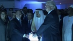 Egyptian President Abdel Fattah al-Sisi, left, Saudi King Salaman and U.S. President Donald Trump place their hands on a glowing orb to open the Global Center for Combating Extremism in Riyadh, Saudi Arabia, on May 21, 2017. (AP / YouTube)
