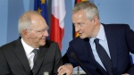 German Finance Minister Wolfgang Schaeuble, left, and Bruno Le Maire, economy minister of France, right, arrive for a joint press conference after a meeting in Berlin, Germany, May 22, 2017. (Michael Sohn/AP)