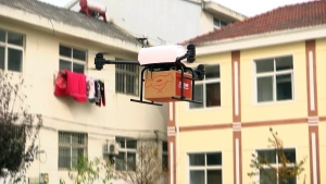 In this image taken from a Nov. 9, 2016 video footage by AP Video, a drone takes off to deliver JD.com parcel from Tiantong'an village near Suqian city in eastern China's Jiangsu province. (AP Video via AP)
