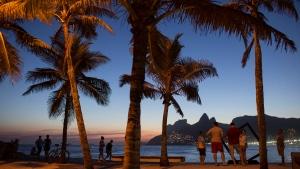 People watch the sun set from Arpoador beach in Rio de Janeiro, Brazil on March 21, 2016. (Felipe Dana/AP)