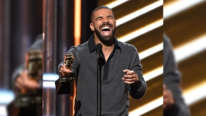 "Drake accepts the award for top Billboard 200 album for ""Views"" at the Billboard Music Awards at the T-Mobile Arena on Sunday, May 21, 2017, in Las Vegas. Drake surpassed Adele's record at the 2017 Billboard Music Awards on Sunday, picking up 13 awards. (Photo by Chris Pizzello/Invision/AP)"