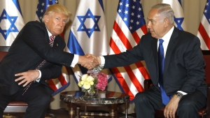 "Israel's Prime Minister Benjamin Netanyahu, right and U.S. President Donald Trump shake hands during a meeting in Jerusalem on Monday, May 22, 2017. President Donald Trump is opening his first visit to Israel Monday, saying he sees growing recognition among Muslim nations that they share a ""common cause"" with Israel in their determination to counter the threats posed by Iran. ( Menahem Kahana, Pool via AP)"