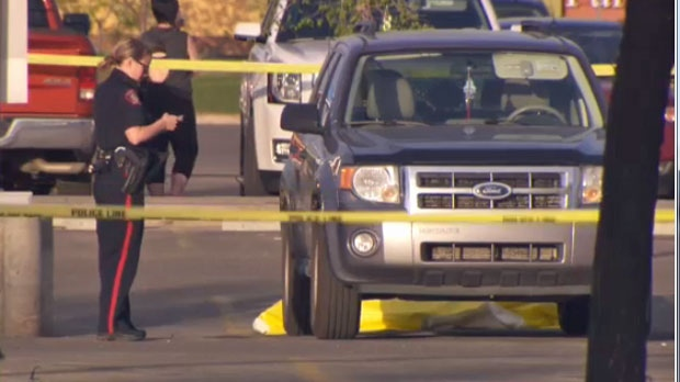 A CPS member at the scene of Sunday night's shooting in the parking lot of the Real Canadian Superstore in McKenzie