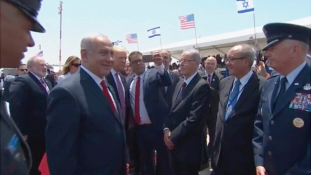 Oren Hazan, an Israeli lawmaker takes a selfie with U.S. President Donald Trump during a welcoming ceremony at Ben-Gurion International Airport, in Tel Aviv, Israel, Monday May 22, 2017. (Israeli Government Press Office via AP)