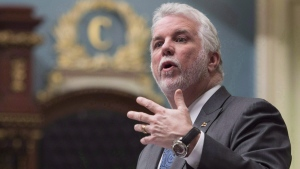Quebec Premier Philippe Couillard responds to Opposition questions over former premier Jean Charest and Marc Bibeau, during question period Tuesday, April 25, 2017 at the legislature in Quebec City. (Jacques Boissinot/The Canadian Press)