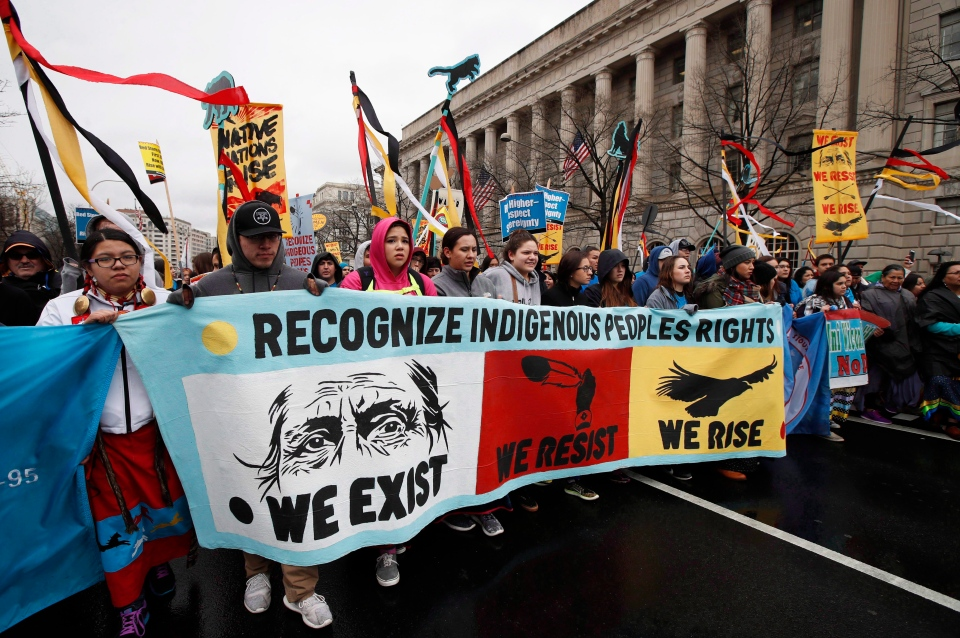 Native groups and their supporters march toward the White House in Washington, Friday, March 10, 2017, to rally against continued construction of the disputed Dakota Access pipeline. (The Canadian Press/AP/Manuel Balce Ceneta)