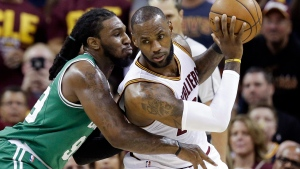 Cleveland Cavaliers' LeBron James, right, backs down Boston Celtics' Jae Crowder (99) during the first half of Game 3 of the NBA basketball Eastern Conference finals, Sunday, May 21, 2017, in Cleveland. (AP Photo/Tony Dejak)