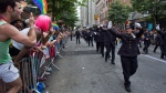 Members of the Gay Officers Action League of the New York police department are cheered during the gay pride march in New York Sunday, June 30, 2013. (AP Photo/Craig Ruttle)