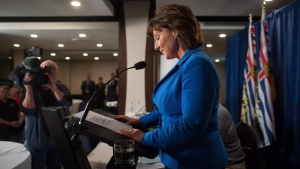 British Columbia Premier Christy Clark pauses to read her notes while addressing MLAs during a caucus meeting at a hotel in Vancouver on May 16, 2017. (Darryl Dyck / THE CANADIAN PRESS)