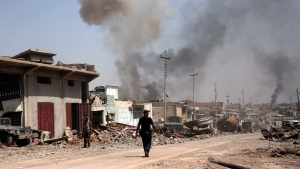 In this Tuesday, May 9, 2017 file photo, smoke rises during heavy fighting between Islamic State militants and Iraqi special forces in the industrial area of west Mosul, Iraq. (AP Photo/Maya Alleruzzo, File)