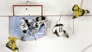 Nashville Predators' Frederick Gaudreau and Colin Wilson watch as a shot by teammate Austin Watson, not shown, gets past Anaheim Ducks goalie Jonathan Bernier, centre, for a goal during the first period in Game 6 of the Western Conference final in the NHL hockey Stanley Cup playoffs in Nashville, Tenn. on Monday, May 22, 2017. (AP / Mark Humphrey)
