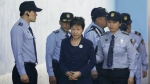 Former South Korean President Park Geun-hye, centre, arrives at a court in Seoul, South Korea for the beginning of her corruption trial on Tuesday, May 23, 2017. (Kim Hong-ji / Pool Photo)