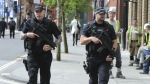 Armed police patrol the streets near to Manchester Arena in central Manchester, England on Tuesday, May 23, 2017. (AP / Rui Vieira)