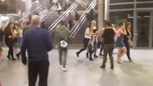 People running through Manchester Victoria station after an explosion at Manchester Arena in Manchester, England, on May 22, 2017. (Zach Bruce/PA via AP)