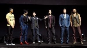 Zack Snyder, center, director of the upcoming film 'Justice League,' addresses the audience with cast members, from left, Ray Fisher, Ezra Miller, Henry Cavill, Ben Affleck and Jason Momoa during the Warner Bros. Pictures presentation at CinemaCon 2017 at Caesars Palace on Wednesday, March 29, 2017, in Las Vegas. (Photo by Chris Pizzello/Invision/AP)