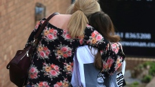 A fan is comforted after Manchester attack