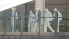 Police forensic investigators in Manchester