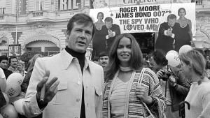 "Roger Moore and Barbara Bach at a screening of ""The Spy Who Loved Me"" at the Cannes Film Festival, on May 20, 1977. (AP)"