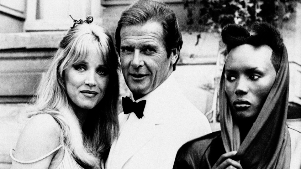 Roger Moore with his co-stars Tanya Roberts, and Grace Jones on the set of the 007 action film 'A View to a Kill,' on Aug. 17, 1984. (Alexis Duclos / AP)