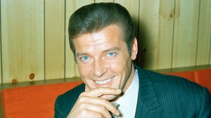"""FILE - This is a May 1968 file photo of British actor Roger Moore of """"The Saint"""" and James Bond fame. Roger Moore's family said Tuesday May 23, 2017 that the former James Bond star has died after a short battle with cancer Ôªø (AP Photo/ File)"""