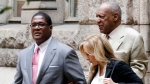 Bill Cosby, right rear, arrives with one of his attorneys Angela Agrusa, centre, for the second day of jury selection in his sexual assault case at the Allegheny County Courthouse in Pittsburgh, Tuesday, May 23, 2017. (AP Photo/Gene J. Puskar)
