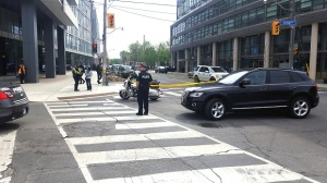 Toronto police at the scene of a collision where a cyclist was pinned underneath a vehicle in Leslieville. (Jorge Costa/CTV News Toronto)