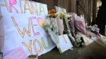 Flower tributes at St Ann's square, Manchester, England, Tuesday May 23, 2017. (AP Photo/Rui Vieira)