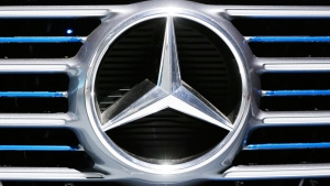 A Daimler logo is fixed at the front of a concept car in Stuttgart, Germany. (Michael Probst / AP)