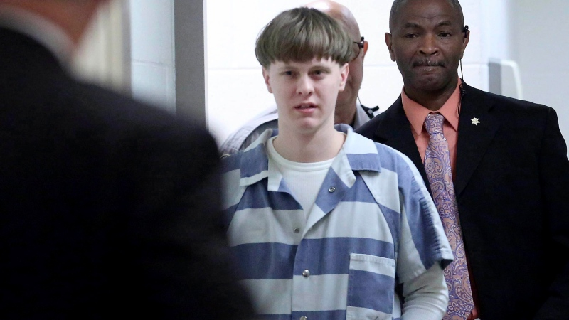 Dylann Roof enters the court room at the Charleston County Judicial Center to enter his guilty plea on murder charges in Charleston, S.C. on April 10, 2017. (Grace Beahm/The Post And Courier via AP, Pool, File)