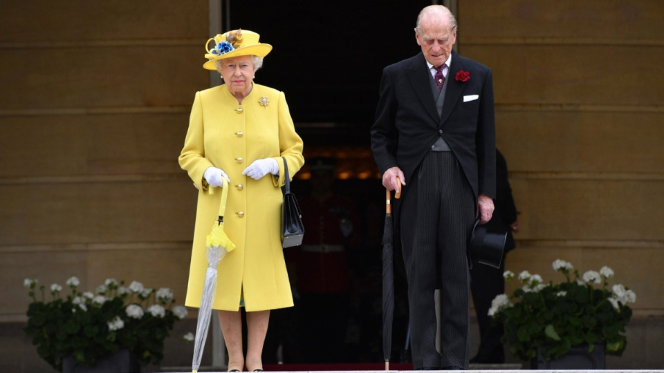 Queen Elizabeth II and Prince Philip observe a minute's silence at Buckingham Palace in London, on May 23, 2017. (Dominic Lipinski/Pool Photo via AP)