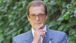 Veteran British actor Roger Moore, poses for a portrait, in the Studio City section of Los Angeles, April 22, 1996. (AP / Chris Pizzello)