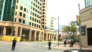 Police block off a portion of Bay Street after a suspicious package was found in a nearby office building.