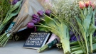 Floral tributes are laid out in Manchester, England, Tuesday May 23, 2017, the day after the suicide attack at an Ariana Grande concert that left 22 people dead as it ended on Monday night. (AP Photo/Kirsty Wigglesworth)