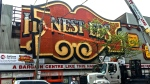 Crews work to dismantle the iconic Honest Ed's sign on May 23, 2017. (Ken Enlow/CTV News Toronto)