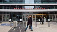 Pedestrians walk past the Air Canada Centre as a screen projects an image of the Toronto Maple Leafs logo in Toronto Wednesday, December 1, 2010. (Darren Calabrese / THE CANADIAN PRESS)